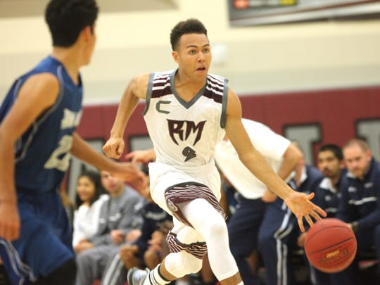 Rancho Mirage High School's Tyrell Robinson looks to make a move to the hoop during his team's game against Jurupa Valley at Rancho Mirage. Rattlers won 77-32.