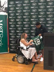 Jets safety Jamal Adams presents Bergenfield High School guidance counselor Lauren LaPorta with a customized jersey. The Jets named LaPorta the winner of the M&T Bank Touchdown for Teachers program.