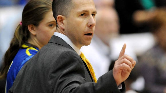 Michael Smith, Booneville's boys and girls basketball coach, will appear in his fifth straight title game today.
