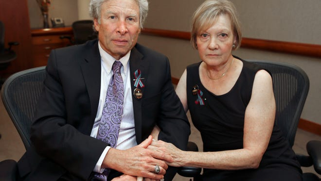 Andy and Barbara Parker, of Collinsville, Va. mourn the loss of their daughter, Alison Parker, a journalist for WDBJ, Friday, Aug. 28, 2015 in Roanoke, Va. Reporter Alison Parker and cameraman Adam Ward were killed by a former colleague during a live broadcast Wednesday, while on assignment in Moneta, Va.