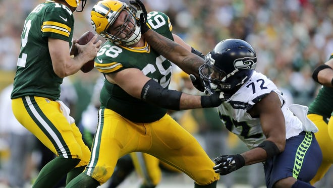 Green Bay Packers offensive tackle Kyle Murphy blocks for quarterback Aaron Rodgers against Seattle Seahawks defensive end Michael Bennett on Sept. 10, 2017, at Lambeau Field.