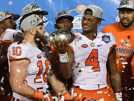Clemson quarterback Deshaun Watson (4) holds the ACC Championship trophy after the Tigers 42-35 win over Virginia Tech at Camping World Stadium in Orlando on Saturday, December 3, 2016.
