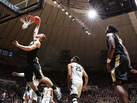Purdue Boilermakers center Isaac Haas (44) dunks against
