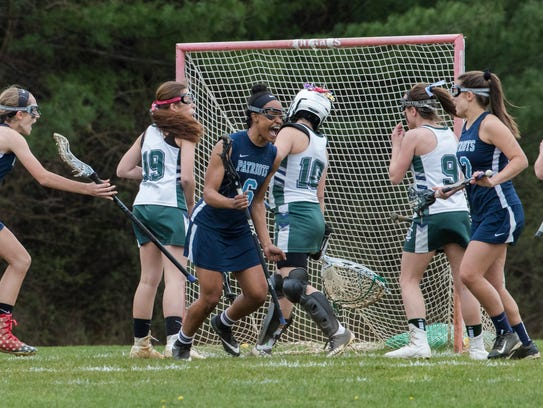 Freehold Township's Cai Martin starts to celebrate after scoring a first half goal. Freehold Township Girls Lacrosse vs Colts Neck in Colts Neck, NJ on April 24, 2018.