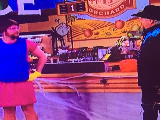 """Chef/host Guy Fieri warily views Kip Poole's """"lunch lady"""" costume on a Halloween episode of """"Guy's Grocery Games"""" on the Food Network."""