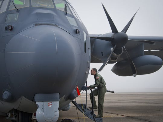 Capt. Steve Visalli boards the newly created AC-130J Ghostrider in anticipation of its first official sortie Jan. 31, 2014 at Eglin Air Force Base, Floridqa. The AC-130J's primary mission is close air support, air interdiction and armed reconnaissance. Visalli is a flight test engineer with the 413th Flight test Squadron.