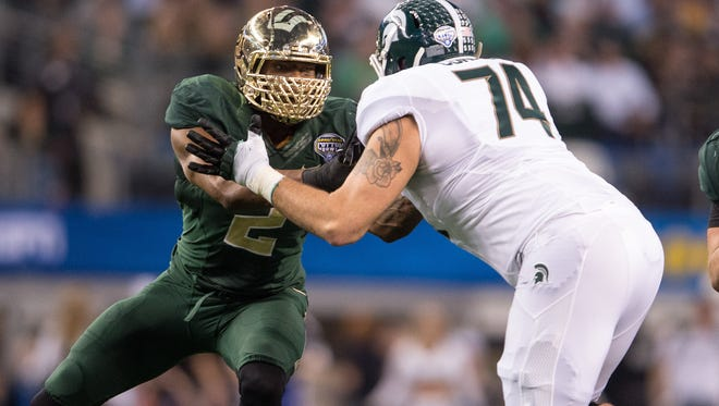 Michigan State Spartans offensive tackle Jack Conklin (74) blocks Baylor Bears defensive end Shawn Oakman (2) during the 2015 Cotton Bowl Classic at AT&T Stadium. The Spartans defeated the Bears 42-41.
