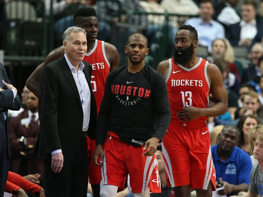 Chris Paul, Mike D'Antoni, Clint Capela and James Harden look on during a break in the action.