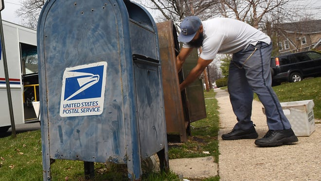 Jimmy Henry, a letter carrier with the United States Postal Service shown on Thursday April 12, 2018.