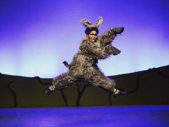 """Marcus Thomas performs as """"Donkey"""" in StageCenter's"""