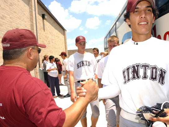 Sinton's Jason Adams and his teammates receive handshakes