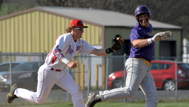 Zane Trace's Tanner Doles tags out Unioto's runner, Isaac Wheeler, caught between second and third base Monday 2016, at Zane Trace High School. The Pioneers defeated the Shermans 14-1 in five innings.