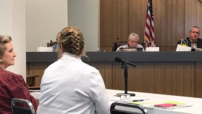 51st District Judge Barbara Walther consults with Tom Green County District Clerk Sheri Woodfin during budget hearings at the Commissioners Court on Wednesday, June 20, 2018.