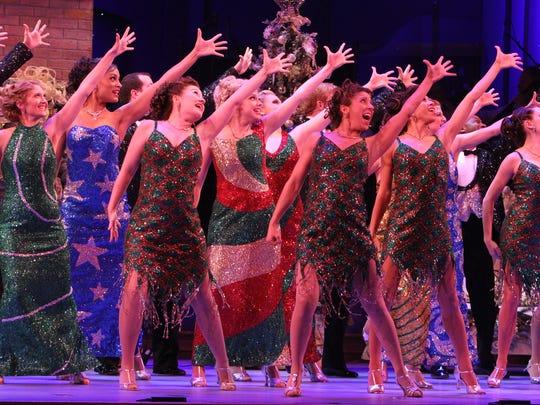 Performers dance during Yuletide Celebration in 2012.