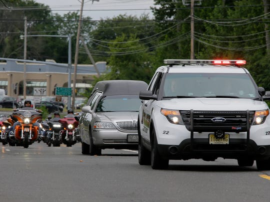 Motorcycle riders escort the body of 20-year-old Cpl. Dan Baldassare, of Colts Neck, a U.S. Marine from Colts Neck who died in a plain crash earlier this month, to Clayton & McGirr Funeral Home in Freehold, NJ from the Dover Air Force Base in Delaware Monday, July 24, 2017.