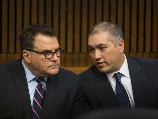 Attorney Richard Convertino, left, speaks to his client former Michigan State Police trooper Mark Bessner at a hearing in Wayne County Circuit Court in Detroit on April 16, 2018.