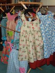 Dresses made by Irene Krall of West Lafayette for Little