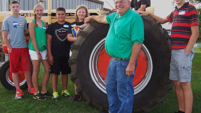 With a Case 830 diesel tractor serving as the setting, Lakeshore Two Cylinder Tractor Club president Gerry Neuser of Mishicot posed with the recipients of 2016 tractor safety course scholarships awarded by the club. Winners (l-r) are Seth Schreiber of Two Rivers, Beth Koele of Random Lake, Bryce Schoenberger of Kiel, Miranda Smith of Valders, Jesse Jensema of Sheboygan Falls, and Alex Phipps of Glenbeulah.