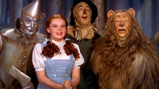 """Jack Haley, left, Judy Garland, Ray Bolger and Bert Lahr in a scene from the 1939 motion picture """"The Wizard of Oz."""""""