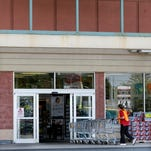 A worker pushes shopping carts July 20, 2015, into an A&P supermarket in North Brunswick, N.J.