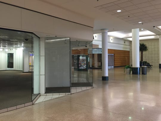 Empty storefronts at Eastland Center mall in Harper