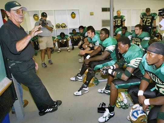 Lincoln football coach David Wilson talks to his team before a game against Mosley.