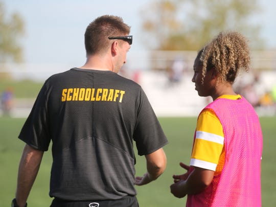 It's a teachable moment Friday as Schoolcraft coach Dave Carver talks with freshman midfielder Laila Muscat.