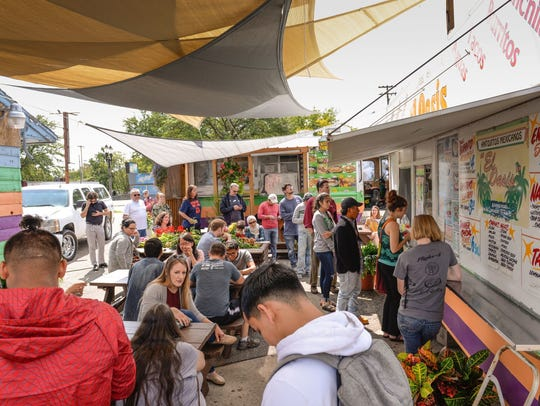 The lunch rush at El Oasis on E. Michigan Avenue on