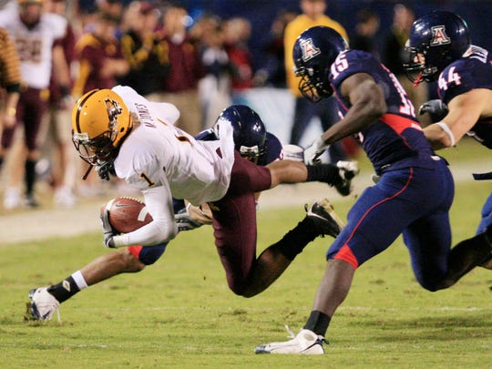 Arizona State's Michael Jones dives for extra yards