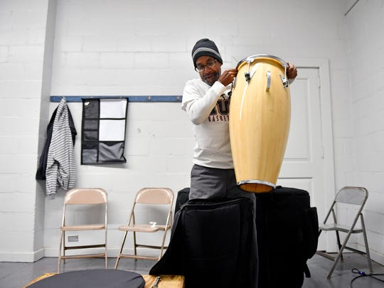 Louis Woodyard packs up his drums for a gig Wednesday, April 11, 2018, at Voni Grimes Gym in York. Woodyard, who works part-time for the city at the gym and Memorial Park, was shot in a case of mistaken identity in October 2016. With help from friends, family and fellow musicians, Woodyard recovered physically but is still working through his Post-Traumatic Stress Disorder.