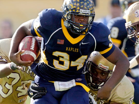 Carlos Hyde (34) tries to escape from St. Augustine defenders during the fourth quarter of the 2007 Class 3A state championship game. Naples won 17-10 at the Citrus Bowl in Orlando to claim the program's second stae title.