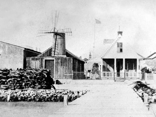 The George F. Evans Warehouse (left) was built on the site of Edward Ohler's store. Next to it were John Anderson's windmill and home in the 600 block of Water Street north of the Peoples street intersection. Cords of wood were stacked in front of the windmill.