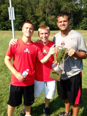Brock Gourley (left) and Blake Gourley (center) have taken over the Harrison High School girls' soccer program, which was previously coached by Tom Bealmear (right).