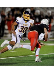 Wylie linebacker Anthony Guerrero (30) chases down