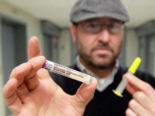 Jason Merrick, chairman of People Advocating Recovery in Northern Kentucky, with a Naloxone kit on the eighth floor of the Kenton County Administration Building, where the group will set up a clinic to dispense the kits.