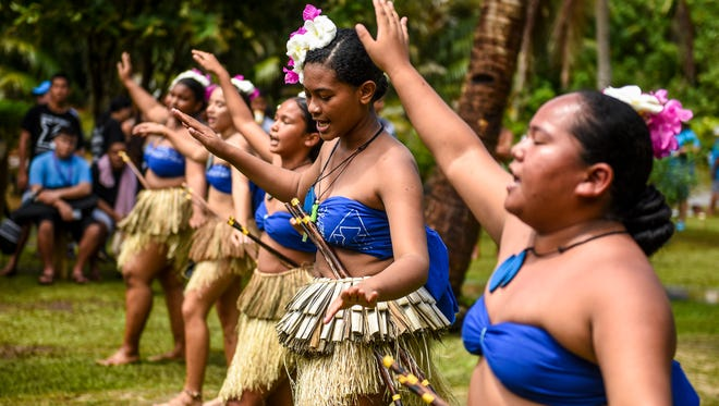 Chamoru cultural dancers perform for festival goers during the third annual Valley of the Latte River Festival in Talofofo on Saturday, April 7, 2018.