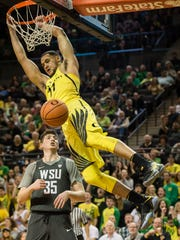Oregon Ducks forward Keith Smith (11) dunks the ball over Washington State Cougars guard Carter Skaggs (35) during the first half at Matthew Knight Arena.