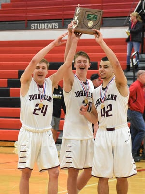 John Glenn seniors Justin Heacock (left), Casey Smith (center) and Shane Bonner (right) hold up the district championship trophy after beating New Philadelphia on Saturday. They lead the Muskies back to The Convo for their fourth regional appearance in five seasons.
