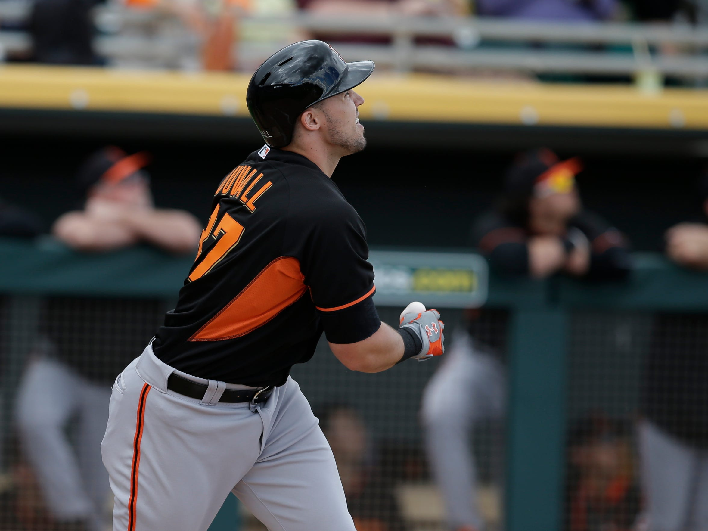 San Francisco Giants' Adam Duvall (37) in action during a spring training baseball game against the Oakland Athletics Tuesday, March 3, 2015, in Mesa, Ariz. (AP Photo/Darron Cummings)