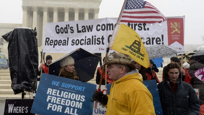 Opponents of the Obama administration's 'contraceptive mandate' protest outside the Supreme Court in March 2014, when the justices considered a case brought by Hobby Lobby.