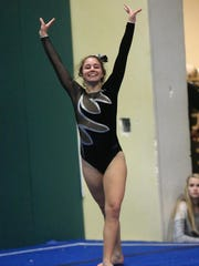 Finishing her floor exercise routine Tuesday is Plymouth's
