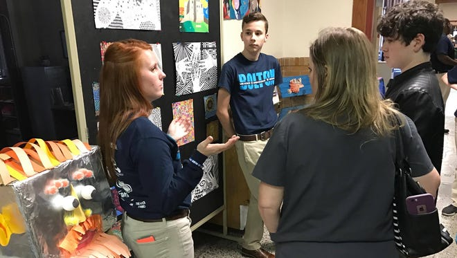 Bolton students Morgan Brame (left) and Jack Noles Jr. talk to parents and prospective students during an open house at the high school held Thursday, Jan. 26. Several Rapides Parish schools have similar upcoming opportunities for families during February, which is the month where students can open enroll in high schools, magnet programs and choice schools.