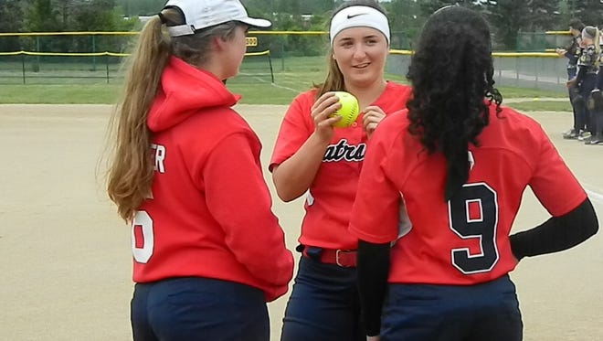 Livonia Franklin co-captains (from left) Melissa Ferrier, Brooke Garbarino and Miyah Smith enjoy a fun moment.