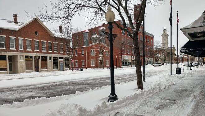 The  view along Paint Street in downtown Chillicothe about 8:30 a.m. Saturday provides a glimpse of the progress being made by city crews after the ice and snow storm.