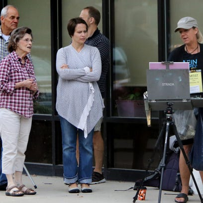 Pedestrians stop to watch Shelby Keefe work on her art at the interesection of Oakland and Kensington avenues in the two-hour quick paint competition during the Shorewood Plein Air event in 2015.