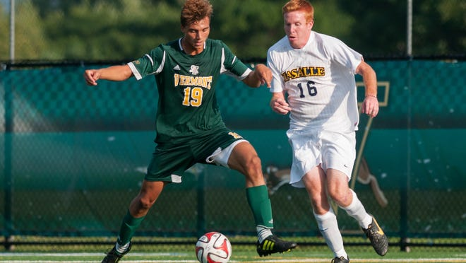 Vermont's Nile Walwyn (19) and LaSalle's Conor Nichols (16) battle for the ball during the men's soccer game at Virtue Field on Sept. 5, 2014.