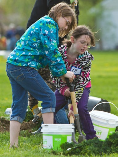 Volunteers and sisters Heaven, left, and Sybil Watt dig a hole for a shrub for an arboretum around Glen Acres Elementary Saturday, May 3, 2014, in Lafayette. The arboretum was created during Tree Lafayette's Arbor Day celebration.