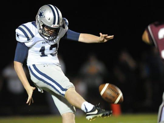 Farragut's Joe Doyle (13) punts to Bearden during a high school football game at Bearden High School on Friday, Sept. 11, 2015. (ADAM LAU/NEWS SENTINEL)