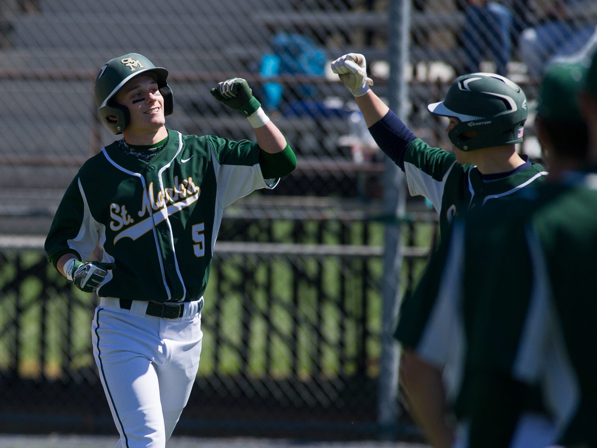 St. Mark's Tyler Kaczmarczyk (5) celebrates with his team after hitting a home run in the first inning against Caesar Rodney.