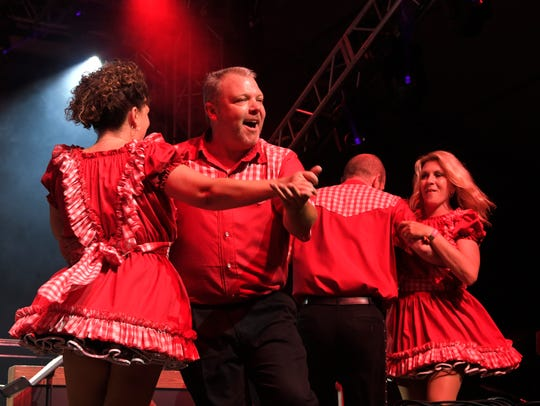 Square dancers perform at the Grand Ole Opry on the